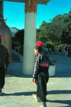 to Jpeg K Blue Hmong boy walking through Wat Doe Suthep