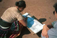 to Jpeg 39K Blue Hmong woman applying wax to a piece of cotton fabric for a skirt (before dyeing with indigo) 8812n30A