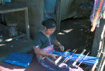 to Jpeg 28K Sgaw Karen woman weaving at her backstrap loom dressed in a traditional hand-woven blouse 8812o36B.jpg