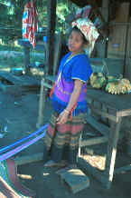 to Jpeg 33K Sgaw Karen woman standing by her backstrap loom dressed in a traditional hand-woven blouse 8812o37.jpg