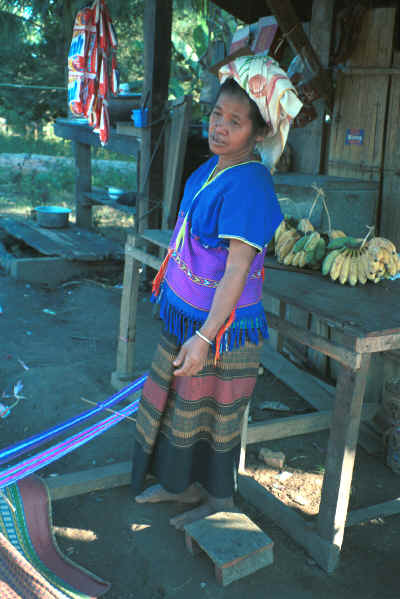 Sgaw Karen woman standing by her backstrap loom dressed in a traditional hand-woven blouse 8812o37.jpg