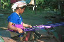 to Jpeg 32K Sgaw Karen woman weaving at her backstrap loom dressed in a traditional hand-woven blouse 8812p01.jpg