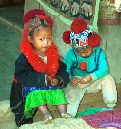 A Yao young girl and boy playing together 8812q06.jpg
