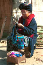 to Jpeg 37K A Yao woman working on her embroidery in a village in the hills around Chiang Rai 8812q10.jpg