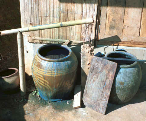 Large earthenware pots holding indigo dye liquid in a Yao village in the hills around Chiang Rai 8812q11.jpg