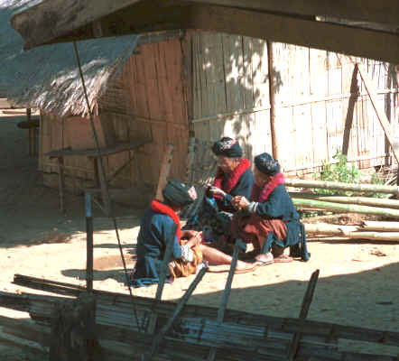 Yao women sitting in the sun working on their embroidery in a village in the hills around Chiang Rai 8812q27.jpg