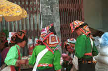 to Photo gallery 29K This photo - BlackThai women examining goods for sale in Ban Vay market on the road from Son La to Dien Bien Phu in Son La Province showing off their embroidered head cloths 9510C21.JPG