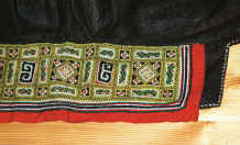 to Jpeg 40K Embroidered underside of a collar on a Black Hmong boy's sleeveless jacket.  This was purchased in Hanoi but similar to those from Black Hmong groups in the Sa Pa area, Lao Cai province 9511A29.JPG
