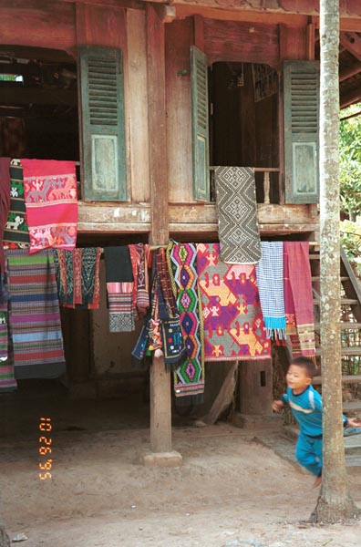 Southern White Thai weavings hanging outside houses in In Ban Lac village in the Mai Chau district, Hoa Binh (Ha So'n Binh) Province 9510A17E