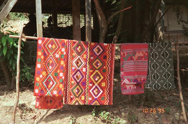 Southern White Thai weavings hanging outside houses in In Ban Lac village in the Mai Chau district, Hoa Binh (Ha So'n Binh) Province, Vietnam 9510A19E