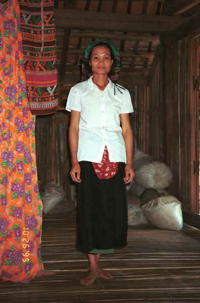 Woman modeling a head cloth in a Southern Thai house in Ban Lac village, Mai Chau District in Hoa Binh Province near the border with the north-western part of Thanh Hoa Province in north west Vietnam 9510A24.JPG